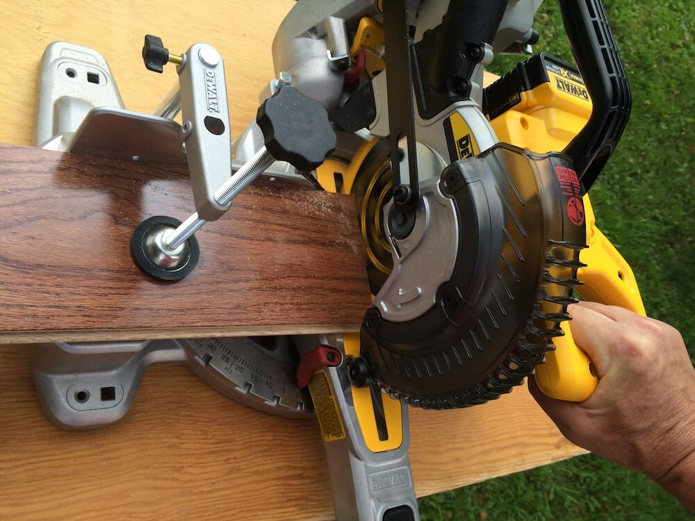 How to unlock miter saw dewalt miter saw judge dewalt you will find the first lock at the back of the tool the up and down movement of the blade is controlled by the first lock greentooth Choice Image